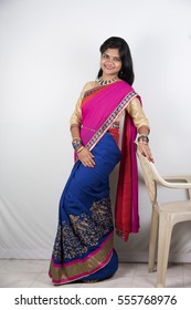 Happy young beautiful traditional Indian woman in traditional saree.