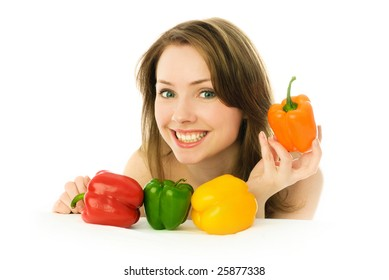 happy young beautiful woman with colorful peppers