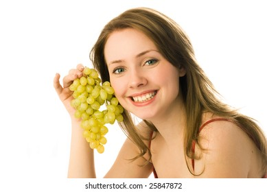 happy young beautiful woman holding grapes in her hand
