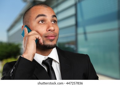 happy young black african man with cell phone