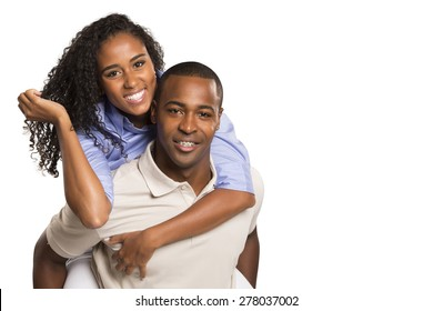 Happy Young Black couple looking at camera smiling