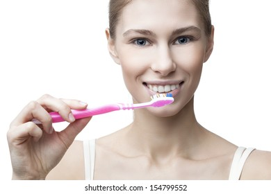 happy young blond woman with toothbrush isolated on white