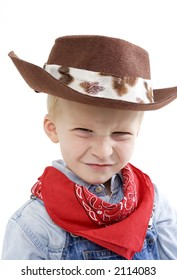 Happy young boy with a cowboy hat making a cute face
