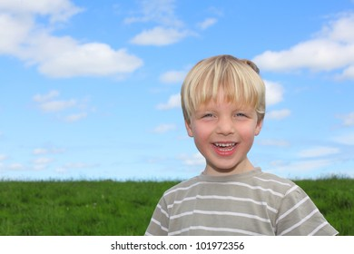 Happy young boy in a meadow