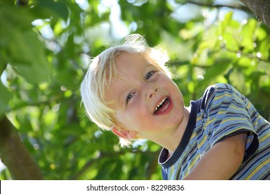 Happy young boy outside in the garden