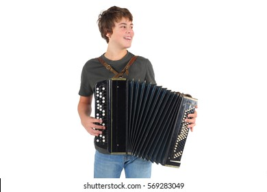 Happy young boy plays accordion and smiles isolated on white background