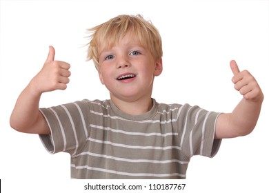 Happy young boy shows thumbs up on white background