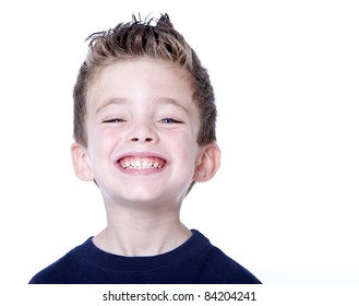 Happy young boy with smile on his face on white
