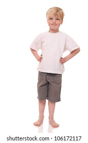 Happy young boy standing on white background