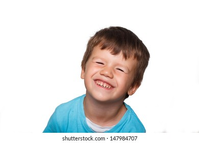 Happy young boy with teeth smile, isolated