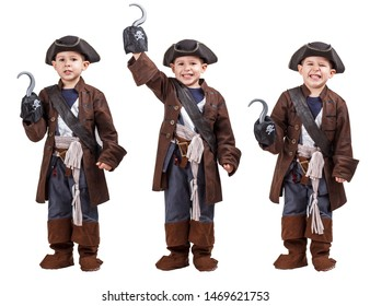 Happy young boy wearing a pirate costume. White background.