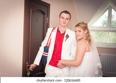 Happy young bride and groom inside on their wedding day - Copyspace. Wedding couple - new family! wedding dress. Bridal wedding bouquet of flowers