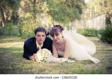 Happy young bride and groom on their wedding day. Wedding couple - new family! wedding dress. Bridal wedding bouquet of flowers