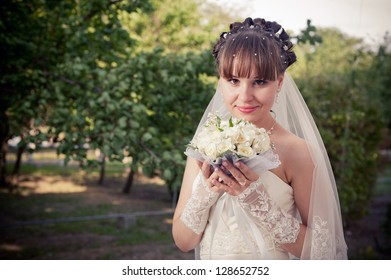Happy young bride  on her wedding day. Wedding couple - new family! wedding dress. Bridal wedding bouquet of flowers