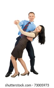 Happy young business couple dancing and laughing, against white background