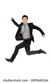 A happy young Business man Jumping up high quality photo