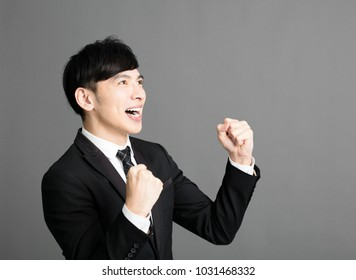 happy young business man with success gesture