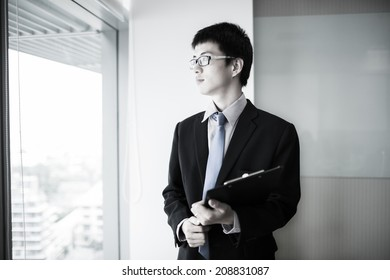 happy young business man work in modern office.Asian