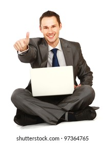 Happy young business man working on a laptop and showing ok, isolated against white background