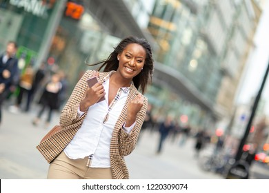 Happy young business woman celebrating an achievement