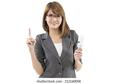 Happy young business woman holding led bulb