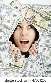 happy young business woman isolated on white playing with dollars money and representing success in finance