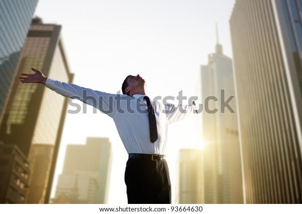 happy young businessman and big city