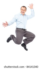 Happy young businessman jumping for joy, isolated on white background