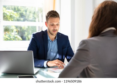 Happy Young Businessman Looking At Candidate During Job Interview