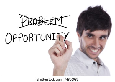 Happy young businessman turning a problem in opportunity (selective focus)