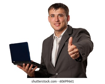Happy young businessman using laptop