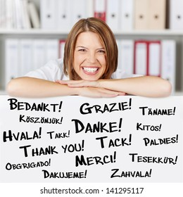Happy young businesswoman says thank you in different languages