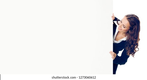 Happy young businesswoman showing blank signboard, isolated over white background. Copyspace blank area for some advertise, slogan or text.