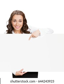 Happy young businesswoman showing signboard, with blank copyspace area for slogan, advertisiment or text message, isolated against white background. Success in business concept studio shot.