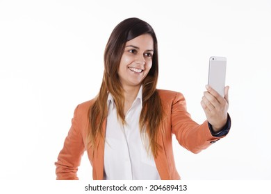 Happy young businesswoman taking herself a photo with a smart-phone