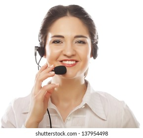Happy young call center executive using headphones and smiling