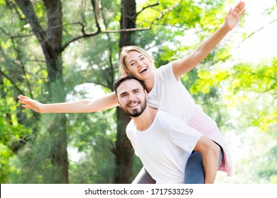 Happy young caucasian couple embracing together with passionate love in public park,Couple in love hugging and having romantic tender moments in the summer vacation.Lifestyle loving couple at nature.
