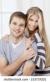 happy young caucasian couple sitting on couch