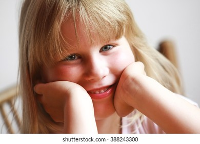 happy young caucasian girl smiling close up