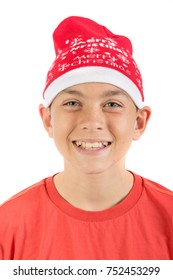 Happy young caucasian teenage boy wearing a Christmas hat isolated on white background