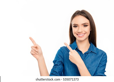 Happy young cheerful woman showing way with fingers