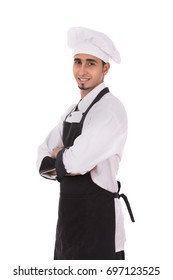 Happy young chef smiling and standing confidently, guy wearing a black chef uniform and chef hat, isolated on white background