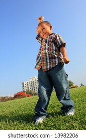 Happy Young Child on a Field