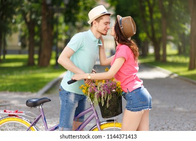Happy young couple with bicycle in the sity. Love, relationship, romance concept.