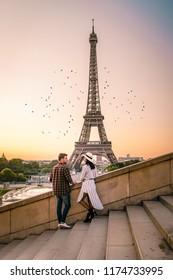 happy young couple by eifel tower at Sunrise, Paris Eifel tower Sunrise man woman in love