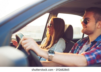 Happy young couple in the car.