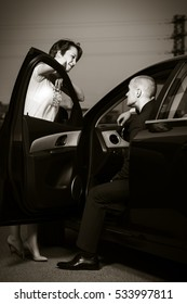 Happy young couple in a car. Male and female fashion model outdoor