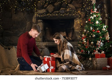 happy young couple celebrates christmas together