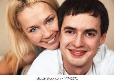 happy young couple; closeup faces