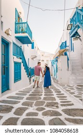 happy young couple Colorful Streets of Mykonos with blue balcony and stairs, Mykonos town Greece